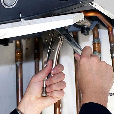 stock-photo-16970470-plumber-at-work