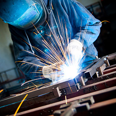stock-photo-18464245-arc-welder-with-welding-sparks